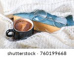 a cup of coffee wrapped in... | Shutterstock . vector #760199668