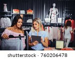two women in a store checking... | Shutterstock . vector #760206478