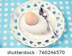 boiled egg on an old plate | Shutterstock . vector #760246570