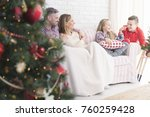 young and happy family sitting... | Shutterstock . vector #760259428