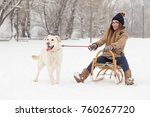 young girl sitting on a sleigh... | Shutterstock . vector #760267720
