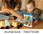 young mother playing with... | Shutterstock . vector #760273108