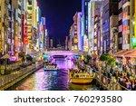 Small photo of Osaka, Japan-November 21, 2017 : Tourist walking in night shopping street at Dotonbori, Dotonbori the famous destination for traveller in Osaka City, Osaka, Japan.