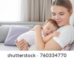 young mother holding sleeping... | Shutterstock . vector #760334770