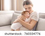 young mother holding sleeping... | Shutterstock . vector #760334776