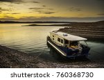 a houseboat moored to a muddy... | Shutterstock . vector #760368730