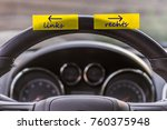 Small photo of Notepad on the steering wheel of a car with the German words left and right for people with right-left weakness