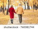 elderly couple walking in park... | Shutterstock . vector #760381744
