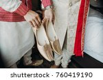 indian groomsman holds golden... | Shutterstock . vector #760419190