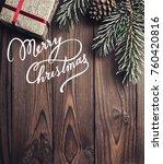 brown wood background. fir tree ... | Shutterstock . vector #760420816