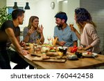 smiling friends at dinner party | Shutterstock . vector #760442458