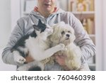 pet owner with dog and cat at... | Shutterstock . vector #760460398
