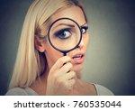 curious woman looking through a ... | Shutterstock . vector #760535044