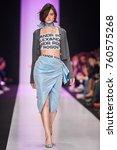 a model walks the runway on the ... | Shutterstock . vector #760575268