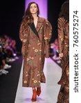 a model walks the runway on the ... | Shutterstock . vector #760575274