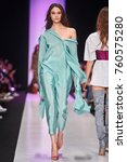 a model walks the runway on the ... | Shutterstock . vector #760575280