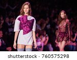 a model walks the runway on the ... | Shutterstock . vector #760575298