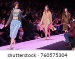 a model walks the runway on the ... | Shutterstock . vector #760575304