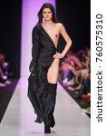 a model walks the runway on the ... | Shutterstock . vector #760575310