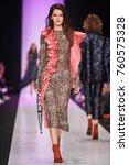 a model walks the runway on the ... | Shutterstock . vector #760575328