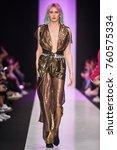 a model walks the runway on the ... | Shutterstock . vector #760575334