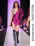 a model walks the runway on the ... | Shutterstock . vector #760575358