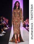 a model walks the runway on the ... | Shutterstock . vector #760575364