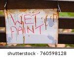 a wet paint sign hanging off... | Shutterstock . vector #760598128
