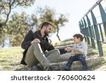 father playing with son in... | Shutterstock . vector #760600624