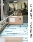 boxes on a conveyor belt in a... | Shutterstock . vector #760616344