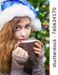 young woman in santa hat... | Shutterstock . vector #760634170