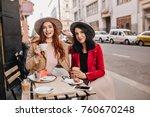 shy caucasian girl in beige... | Shutterstock . vector #760670248