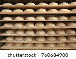 raw loaves of bread on shelves... | Shutterstock . vector #760684900