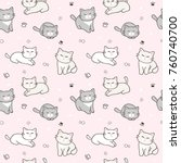 Stock vector seamless pattern of cute cartoon cat design on light pink background 760740700