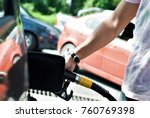 hand refilling the car with... | Shutterstock . vector #760769398