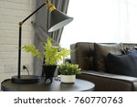 black modern lamp by the sofa... | Shutterstock . vector #760770763