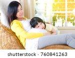 lovely asian child listening to ... | Shutterstock . vector #760841263