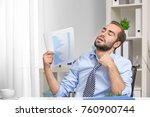 young man feeling hot in office | Shutterstock . vector #760900744