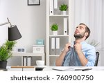 young man feeling hot in office | Shutterstock . vector #760900750