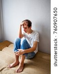 sad young man on the couch in... | Shutterstock . vector #760907650