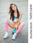 attractive sporty asian woman... | Shutterstock . vector #760911640