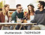 group of people sitting at... | Shutterstock . vector #760945639
