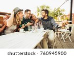 group of people at cafe talking ... | Shutterstock . vector #760945900