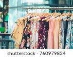 fashion cloth of women on rack | Shutterstock . vector #760979824