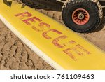 yellow surfboard on the sand... | Shutterstock . vector #761109463