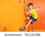 adorable little boy climbing on ... | Shutterstock . vector #761121286