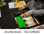 Small photo of Florence, Italy - November 11, 2017: Children build a Lego bricks mosaic during a public competition