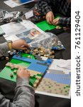 Small photo of Children build a bricks mosaic during a public competition