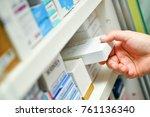 closeup pharmacist hand holding ...   Shutterstock . vector #761136340