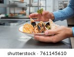 the chef in brown apron cooking ... | Shutterstock . vector #761145610